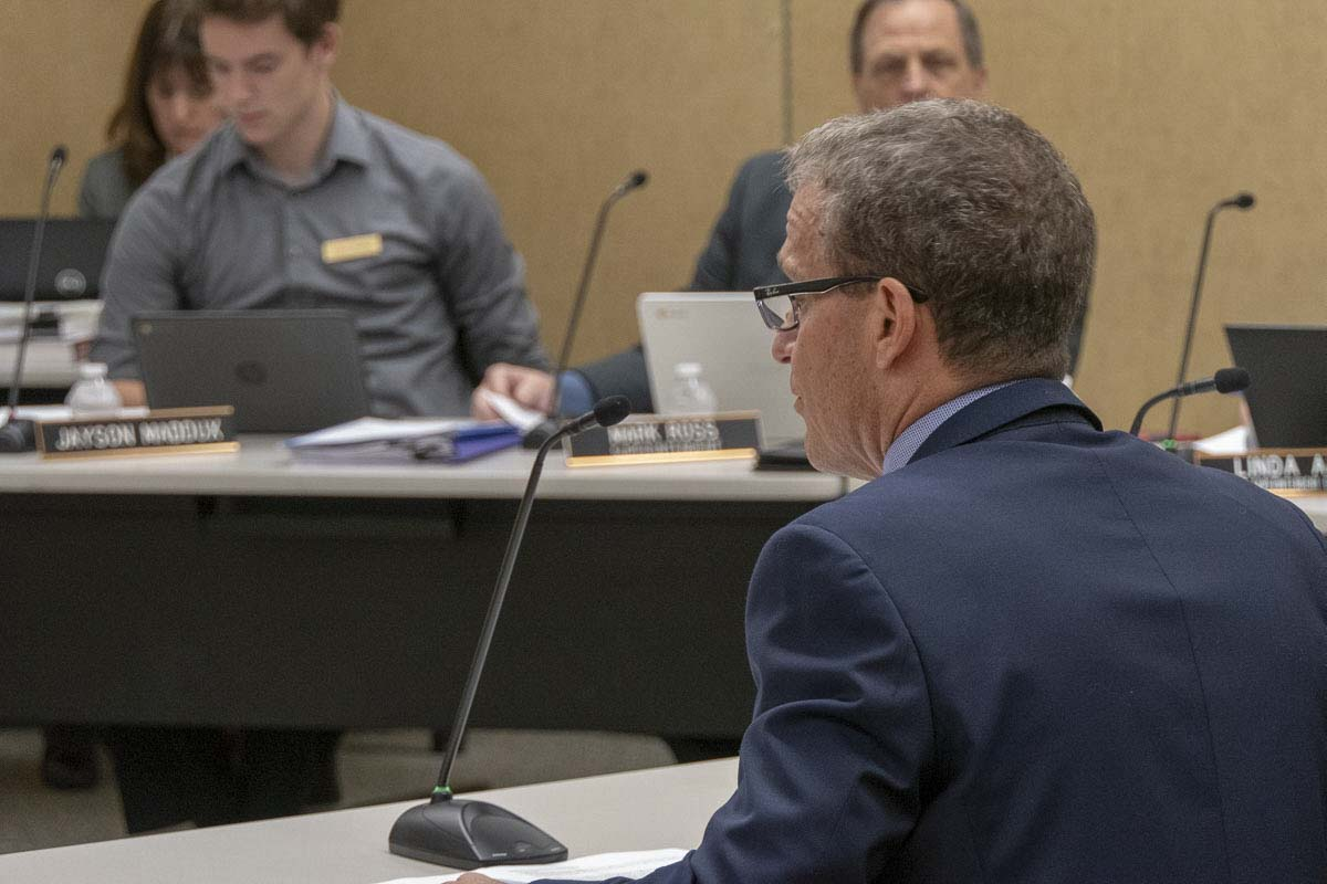 Denny Waters, deputy superintendent for the Battle Ground School District, talks to the board about an overcrowding committee report at Monday's meeting. Photo by Chris Brown
