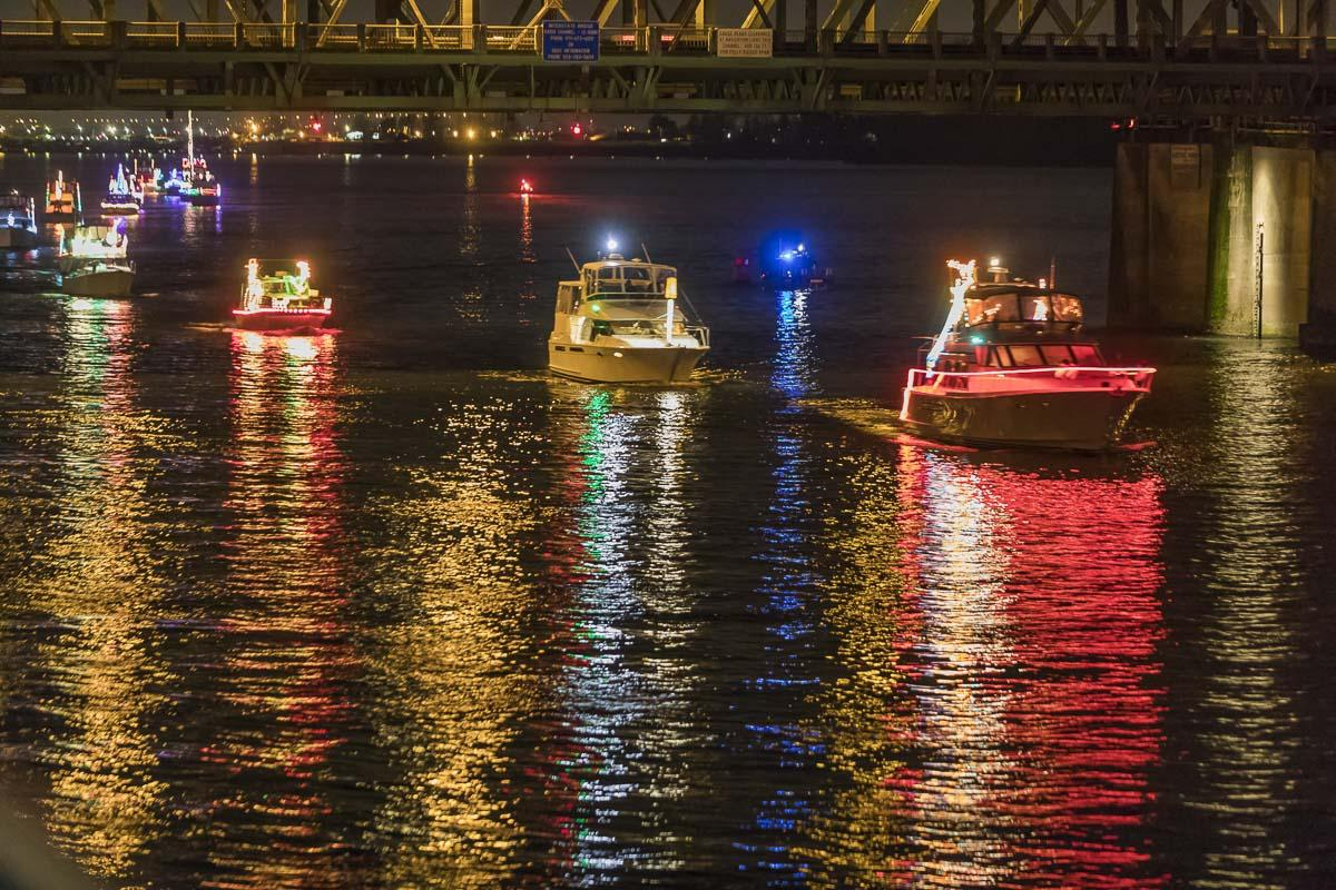 The Christmas Ships of 2017 travel under the I-5 bridge, on their way past Warehouse '23 and what is now the Vancouver Waterfront. Photo by Mike Schultz