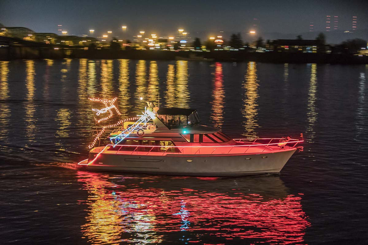 Many boats in the Christmas Ships have onboard generators powerful enough to blast all manner of festive light displays into the night. Photo by Mike Schultz