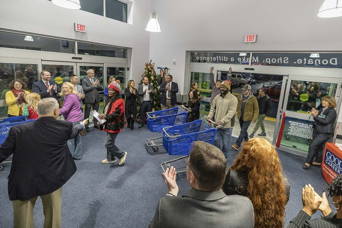 Customers file into the new Goodwill Retail store in Orchards at Thursday's grand opening. Photo by Mike Schultz