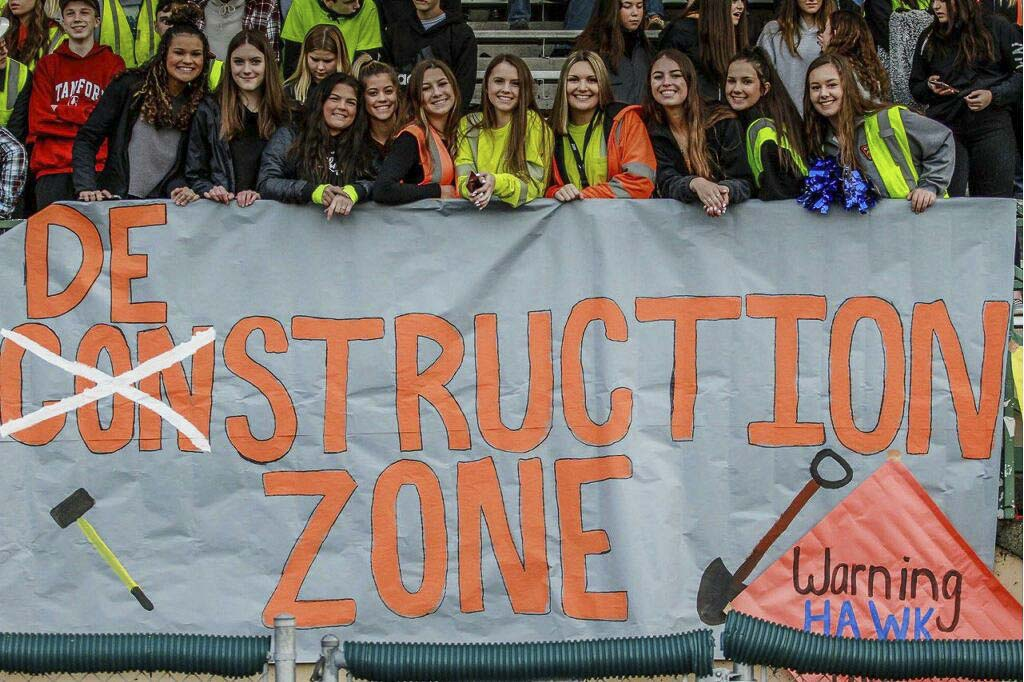 The Hockinson student section went with a Destruction Zone theme for the Hawks' semifinal football game. Brandi Webb, a junior, designs most of the posters, and Stephen Weinmuller, a senior, is one of the spirit leaders for the school. At Hockinson, it is not just a football team, but a football community. Photo courtesy of Jenny Ristau.