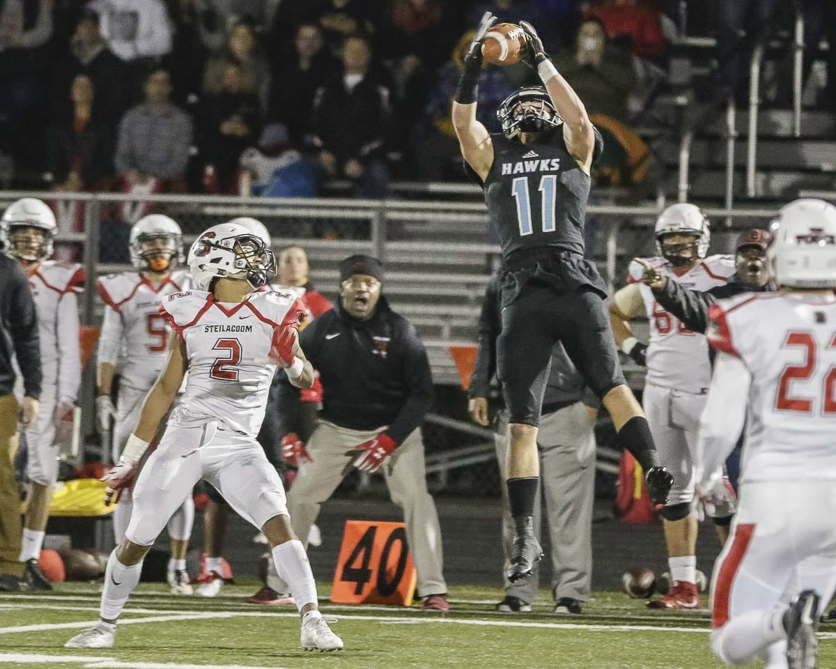 Hockinson receiver Sawyer Racanelli (11) goes high to haul in a pass during Friday's Class 2A state playoff game at Doc Harris Stadium in Camas. Photo by Mike Schultz