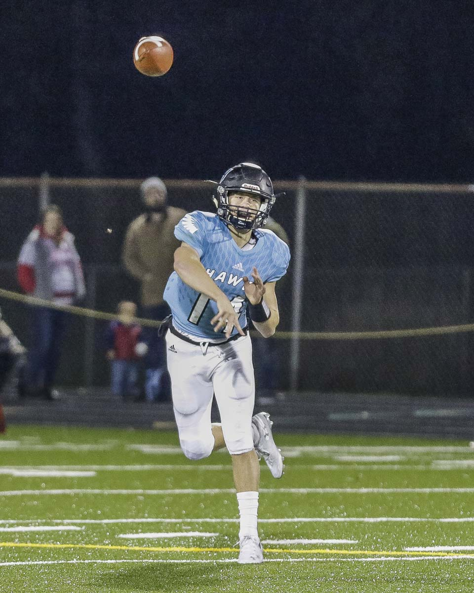 Hockinson quarterback Levi Crum (14) lets fly with a pass attempt in Friday's win over Washington in the first round of the Class 2A state high school football playoffs. Photo by Mike Schultz