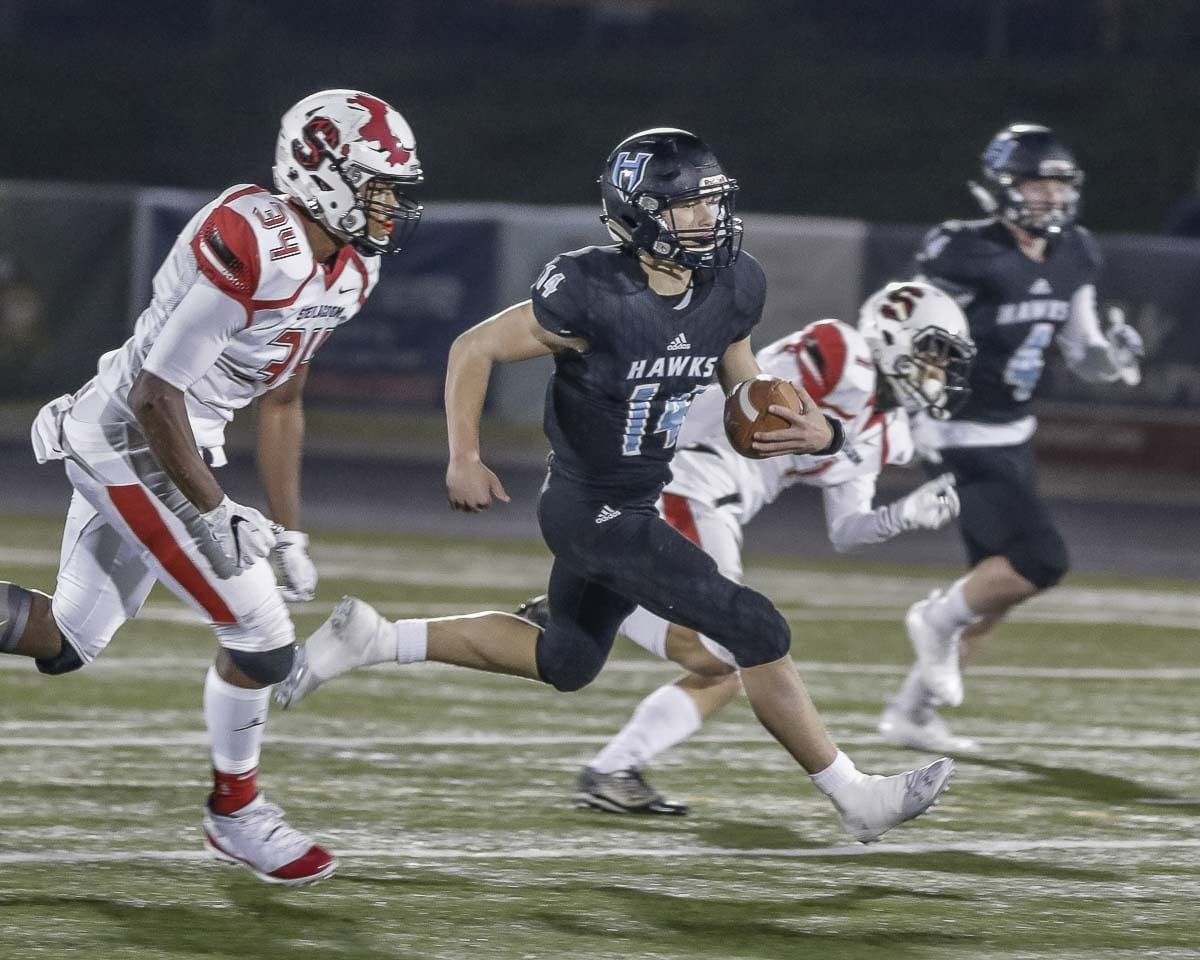 Hockinson quarterback Levi Crum (14) races for yardage during Friday's 35-28 victory over Steilacoom in the Class 2A state high school football playoffs at Doc Harris Stadium in Camas. Photo by Mike Schultz
