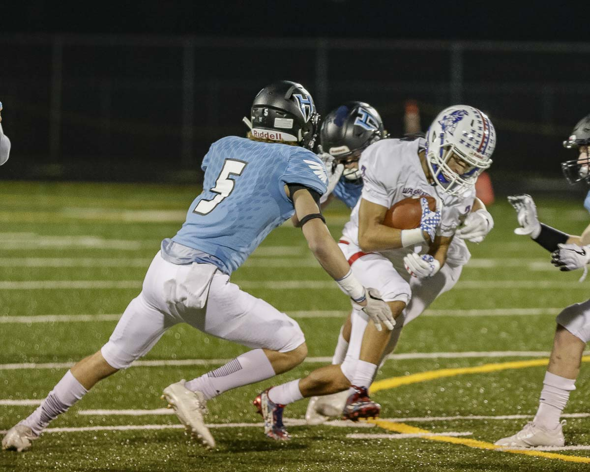 Wyatt Jones (5), known for his big hits as a defensive back, had a huge interception in the state semifinals last week, helping Hockinson come back to beat Liberty. Hockinson plays Lynden in the state title game at 1 p.m. Saturday in the Tacoma Dome. Photo by Mike Schultz