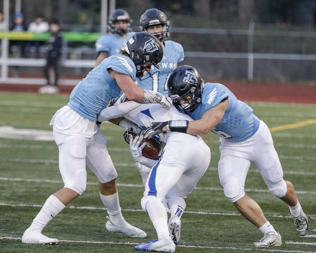 Hockinson's Nick Frichtl (right) also has excelled on defense this season. The linebacker was instrumental in stopping Liberty's final drive in the state semifinals last week, a game Hockinson won 27-24. Photo by Mike Schultz