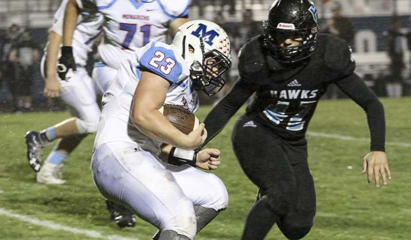 Hockinson linebacker Jon Domingos (42) goes in for a tackle in a game earlier this season. The Hawks, behind a stellar offense and physical defense, are 11-0 this season after winning 14 in a row last year. Photo courtesy of Jenny Ristau.