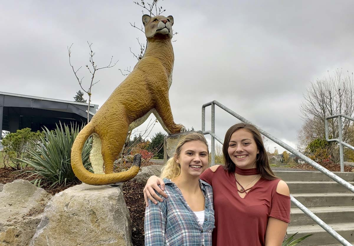 Haley Grotte, left, and Bryanna Ungs will represent La Center at the state swimming championships Friday and Saturday in Federal Way. Grotte, now a junior, started the high school swim team at La Center when she was a freshman. Now there are three members on the team. Photo by Paul Valencia