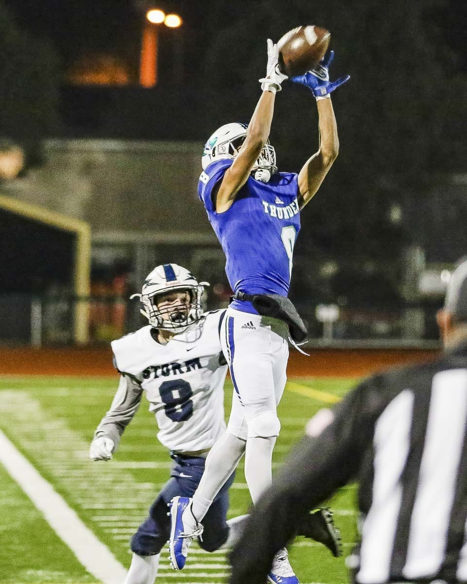 Mountain View receiver Michael Bolds (8) makes a sideline catch in the first half of Friday's state playoff game at McKenzie Stadium. The Thunder defeated Squalicum 42-0 to advance to the state quarterfinals. Photo by Mike Schultz