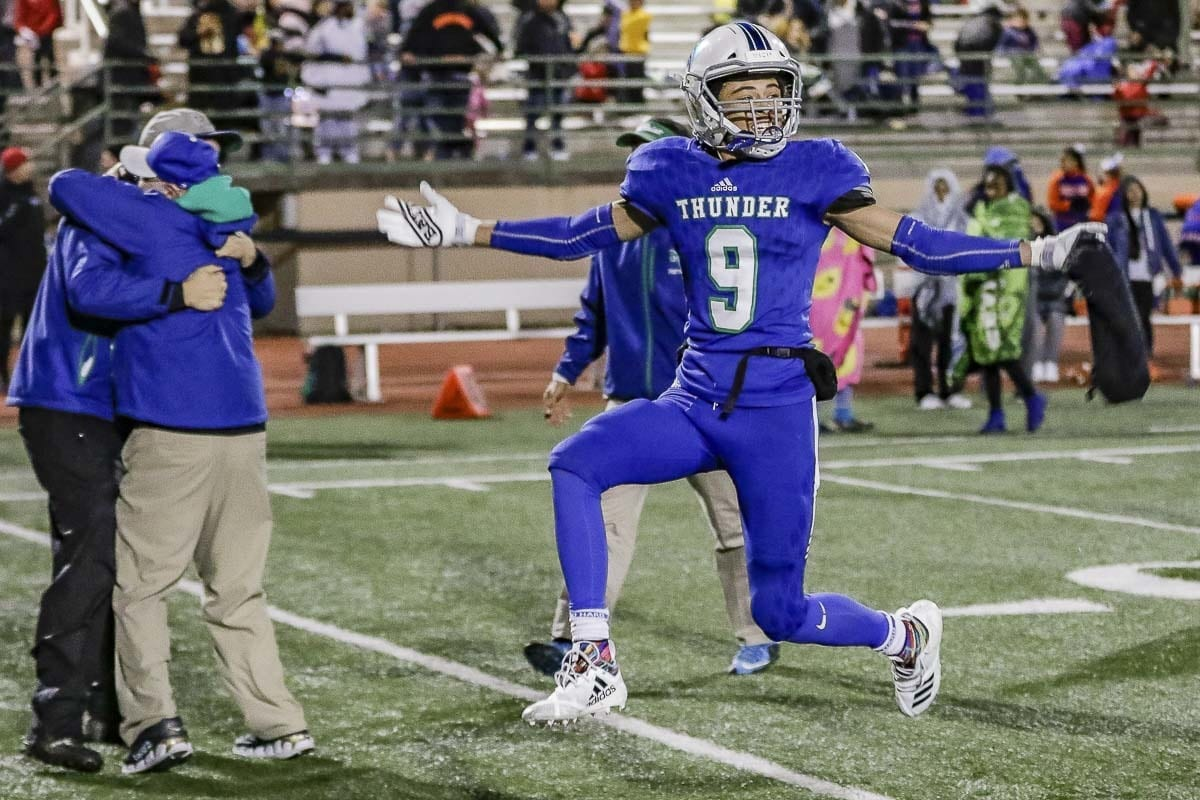 Mountain View receiver Phillip Earnhardt (9) jumps for joy in celebration after the Thunder defeated Rainier Beach 7-6 Saturday to advance to the semifinals of the Class 3A high school state playoffs. Photo by Mike Schultz
