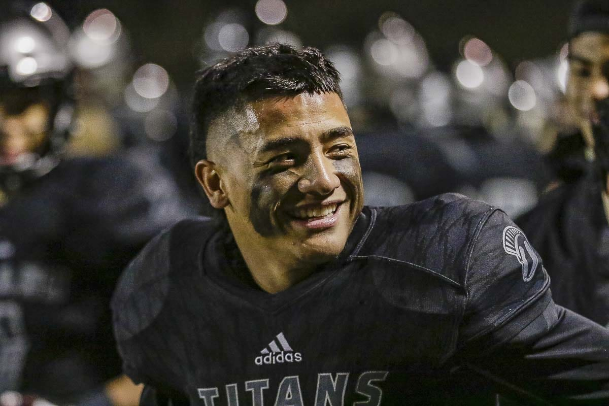 Union quarterback Lincoln Victor had plenty to smile about Friday at McKenzie Stadium as he and his teammates posted a 50-10 win over Skyline in the first round of the Class 4A state football playoffs. Photo by Mike Schultz