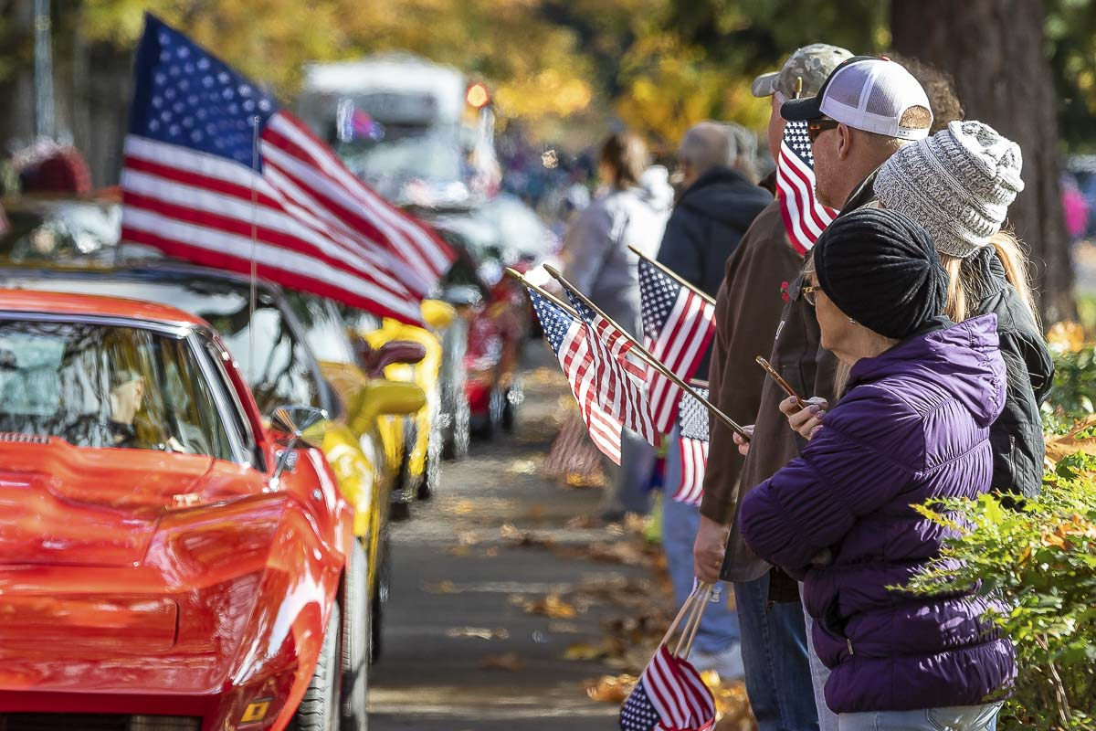 Area residents and visitors lined the street in front of Officer's Row at the Fort Vancouver Historic Site Saturday for the annual Veterans Day Parade. Photo by Mike Schultz