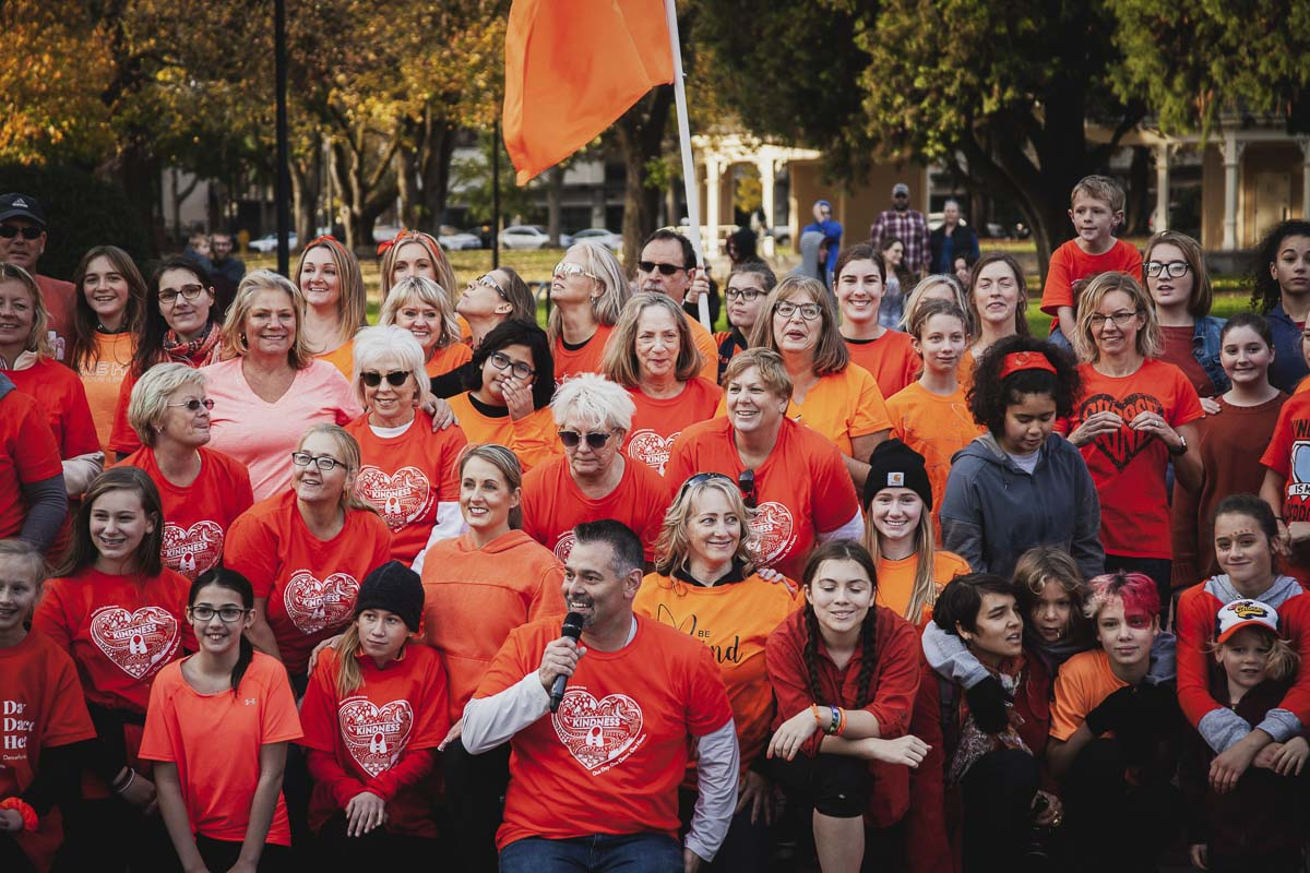 Those who participated in the Dance for Kindness flash mob, pose together for a photo following the event. Local school teacher, Jason Hattrick, holds the microphone. Hattrick brought the nonprofit to Clark County last year. Photo by Alex McFeron