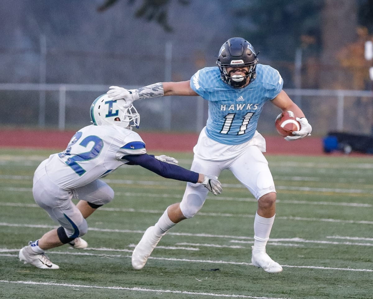 Hockinson senior Sawyer Racanelli (11) had a hand in on all four of the Hawks' touchdowns Saturday in a 27-24 victory over Liberty in the Class 2A state high school football semifinals at McKenzie Stadium. Racanelli rushed for two touchdowns, caught a touchdown pass and also threw for a touchdown. Photo by Mike Schultz