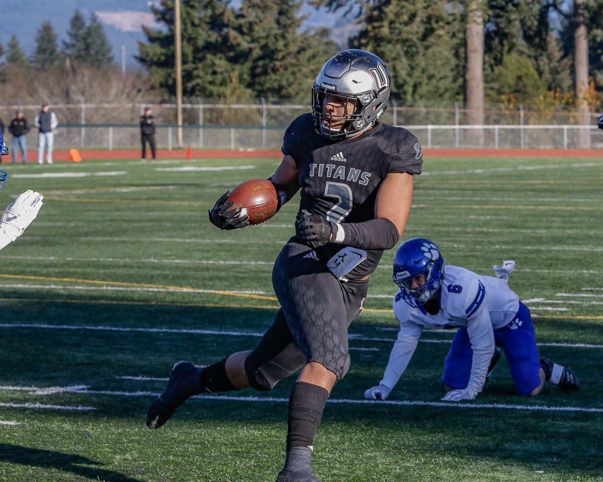 Union's Alishawuan Taylor is a dual threat. He has skills as a wide receiver plus he leads the defense in sacks. Taylor and the Titans face Puyallup in a Class 4A state semifinal game Saturday at McKenzie Stadium. Photo by Mike Schultz