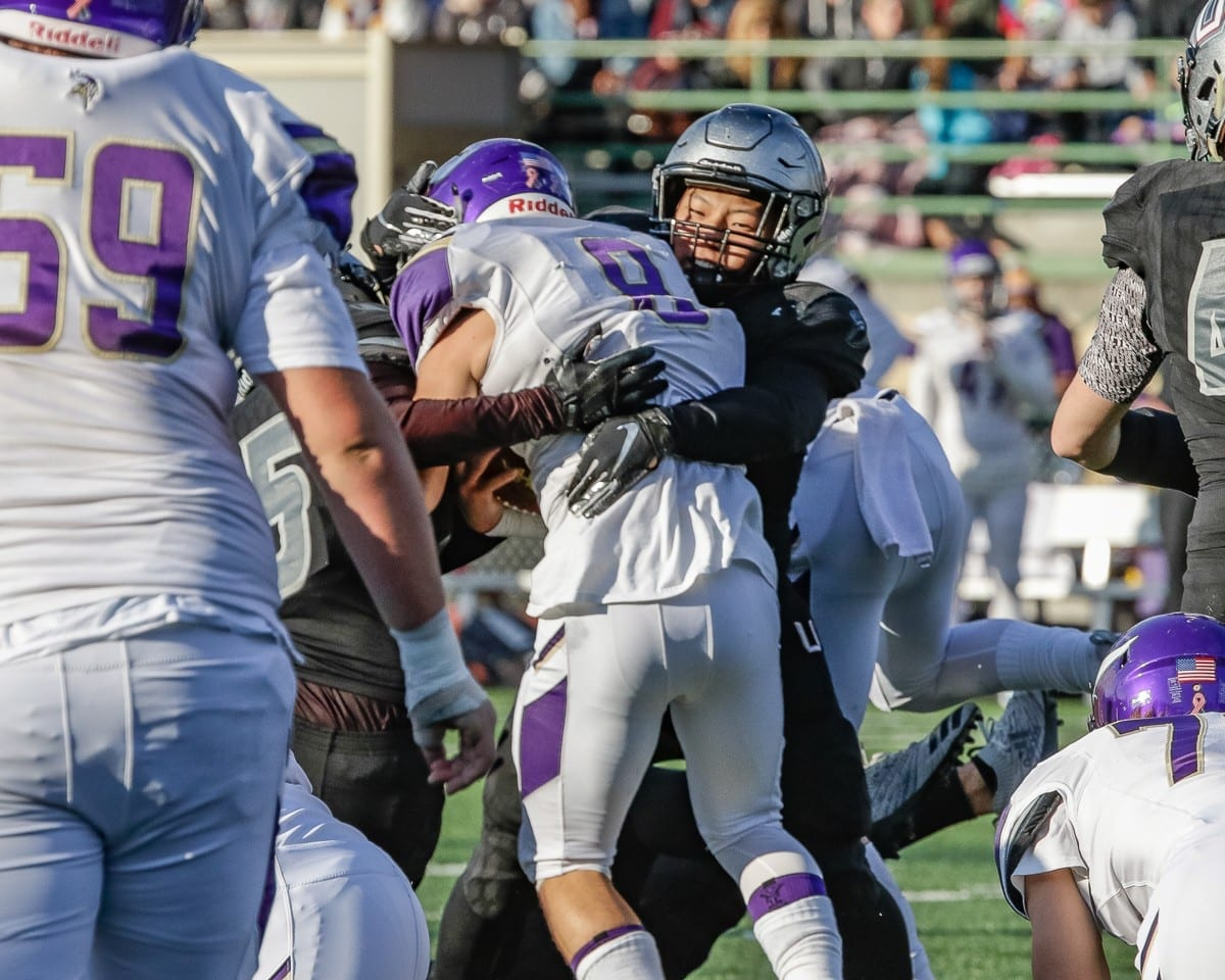 Union linebacker Joshua Joo (29) tackles a Puyallup ball carrier Saturday during the Titans' victory in the Class 4A state semifinals at McKenzie Stadium. Photo by Mike Schultz