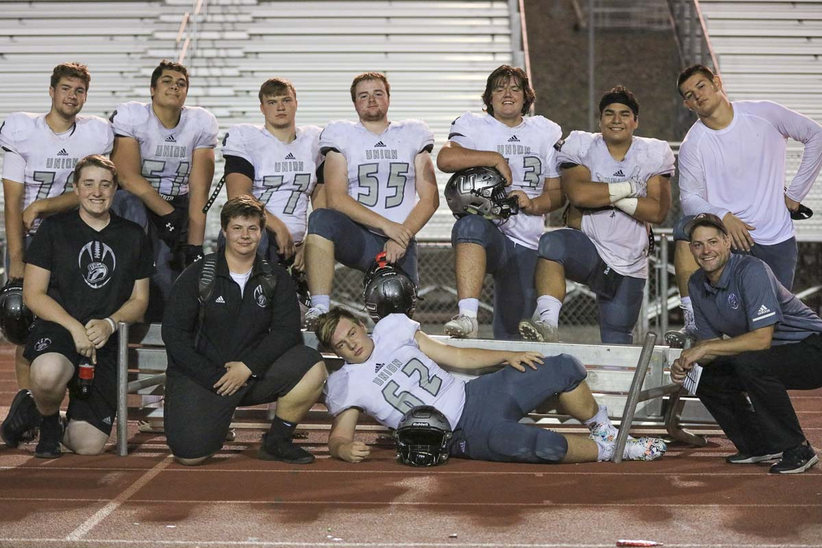 The linemen had a fun moment in a game against Chiawana when they all sat down on the bench, and the bench gave way to all that strength. Photo courtesy of Heather Tianen