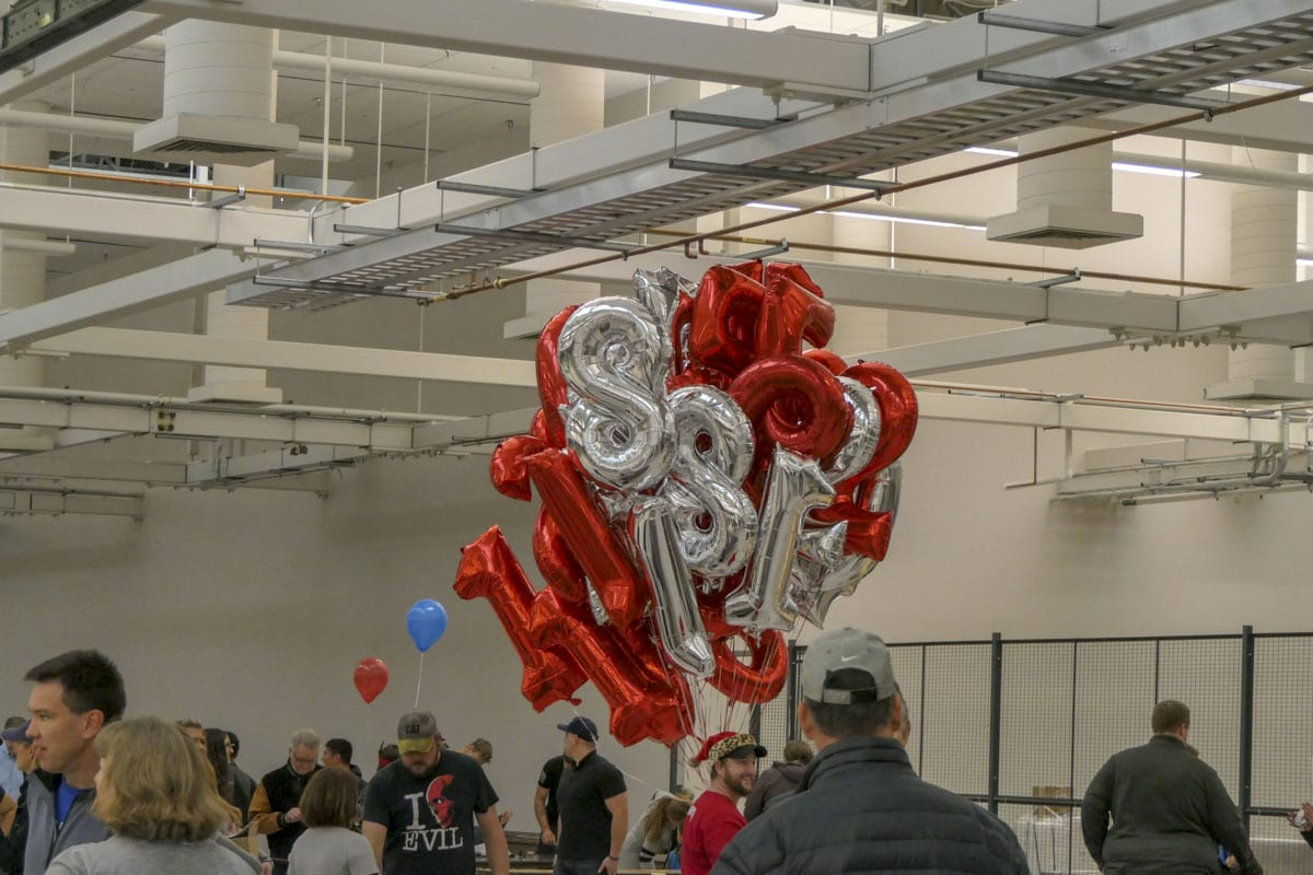 Balloons are handed out to kids at the annual Scott Campbell Christmas Promise bike build event. Photo by Chris Brown