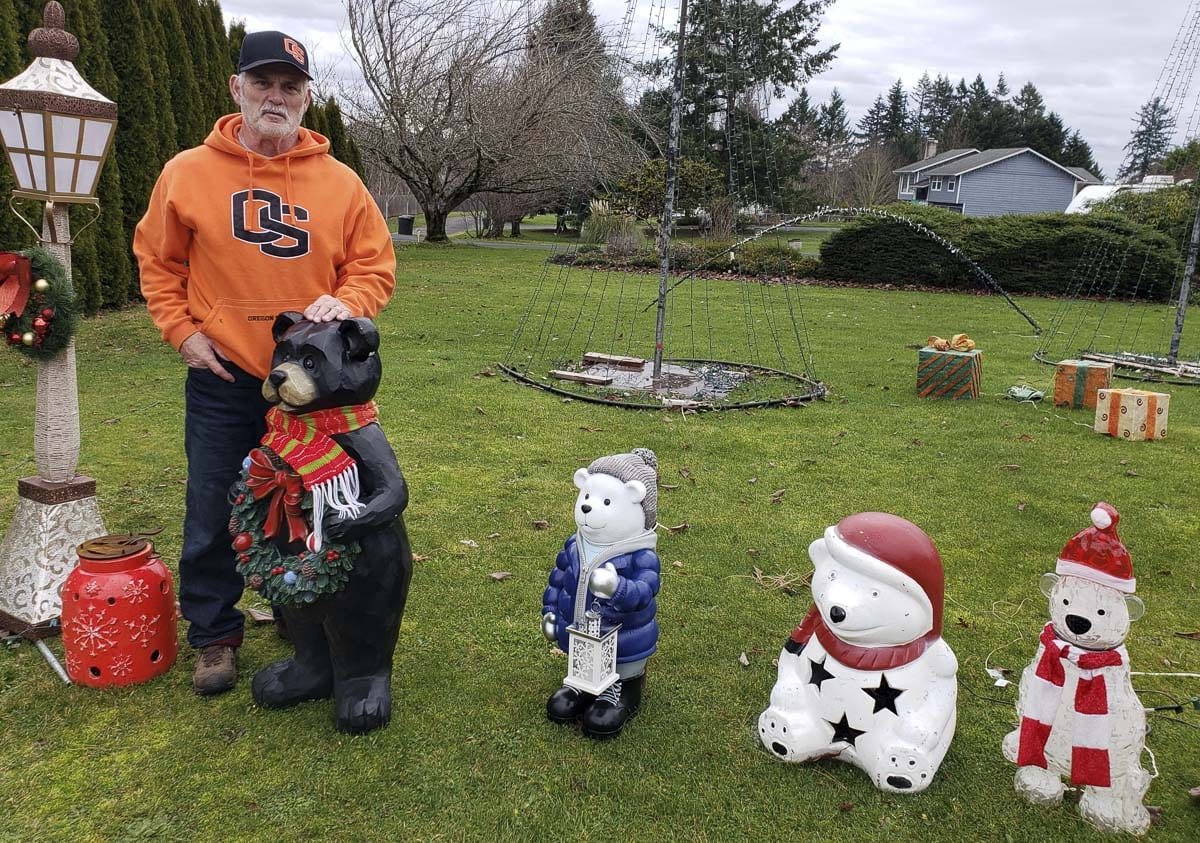 Rick Harrington, a longtime assistant football coach at Camas, got an early start to his Christmas lights display this season. He hopes he will be busy until early December next year. But he promises he will continue hanging out with his bears and other decorations. Photo by Paul Valencia