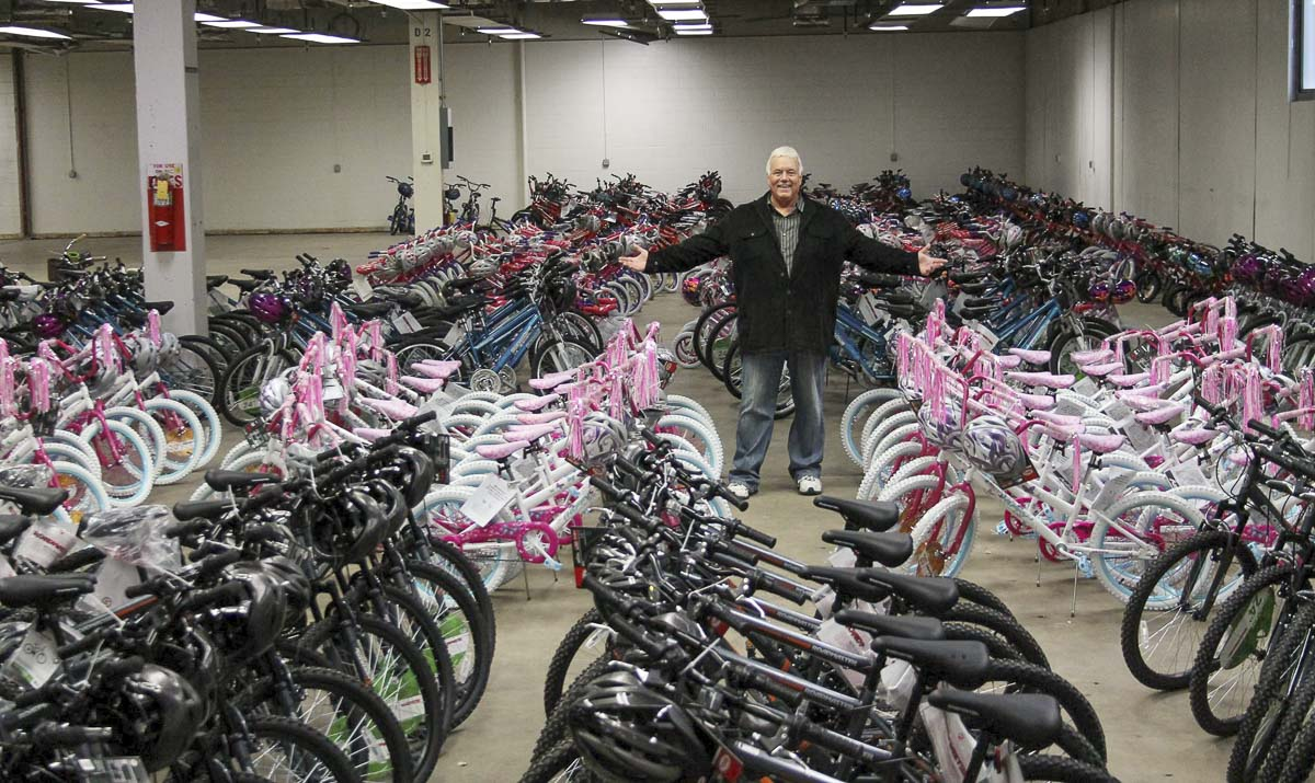 The late Scott Campbell stands amidst hundreds of bikes ready to be donated to local charities. Facebook photo