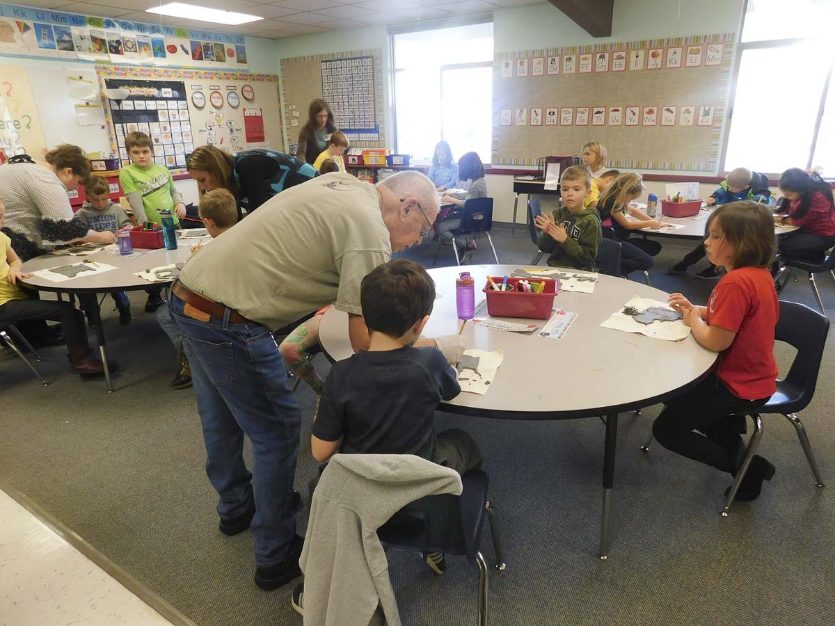 Artist and retired teacher, Richard Moody, helps Union Ridge Elementary School students in Sara Marshall's second grade class make handcrafted ornaments from clay. Photo courtesy of Ridgefield Public Schools