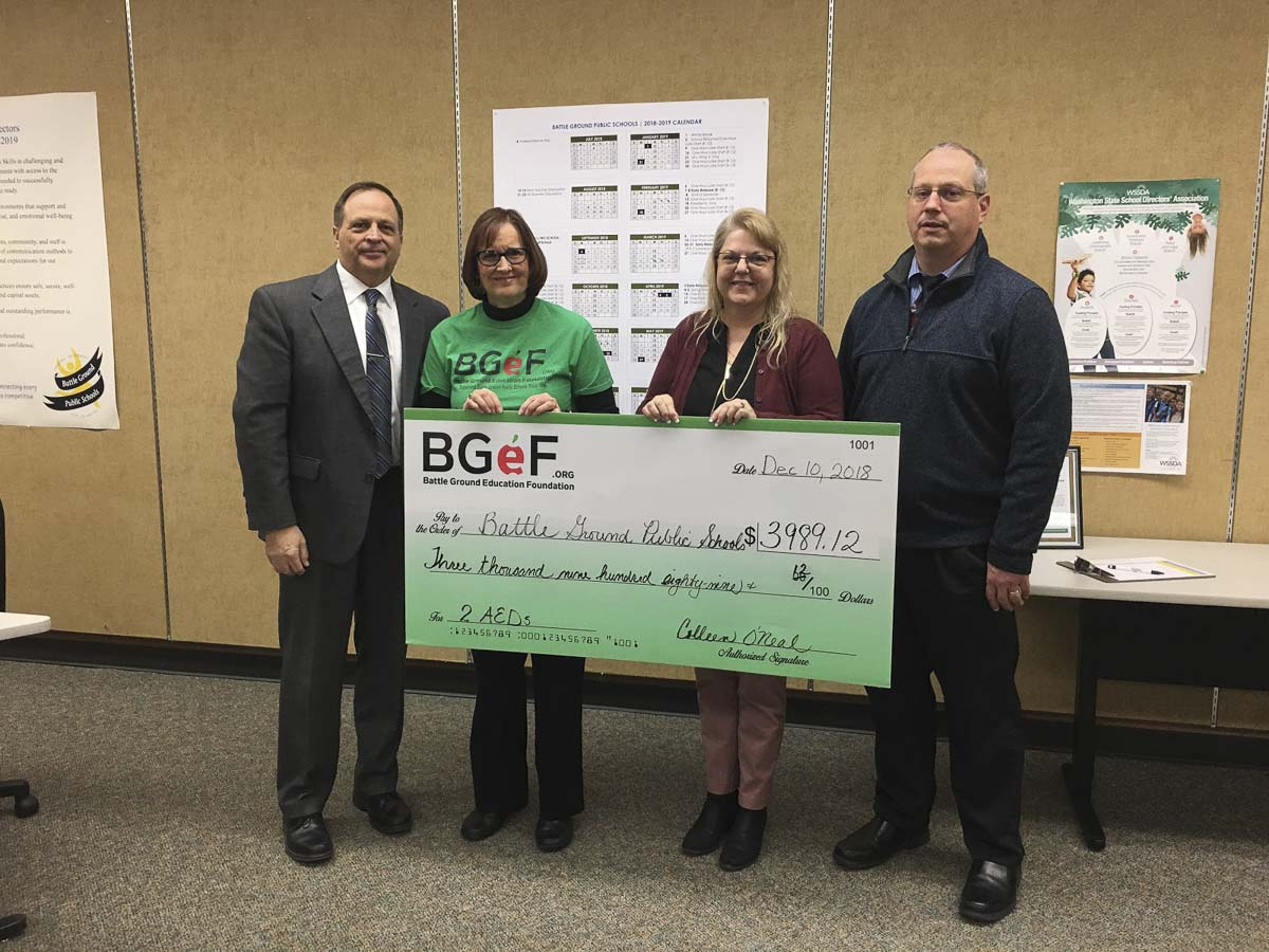 BGPS Superintendent Mark Ross, BGeF President Coleen O'Neal, CAM Academy Assistant Principal Julie Williamson, and BGPS Director of Business & Risk Management Mitch Thompson are shown here (left to right). Photo courtesy of Battle Ground Public Schools