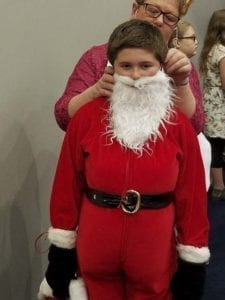 A Battle Ground School District student gets a little help transforming into Santa Claus. Photo courtesy of Battle Ground Public Schools