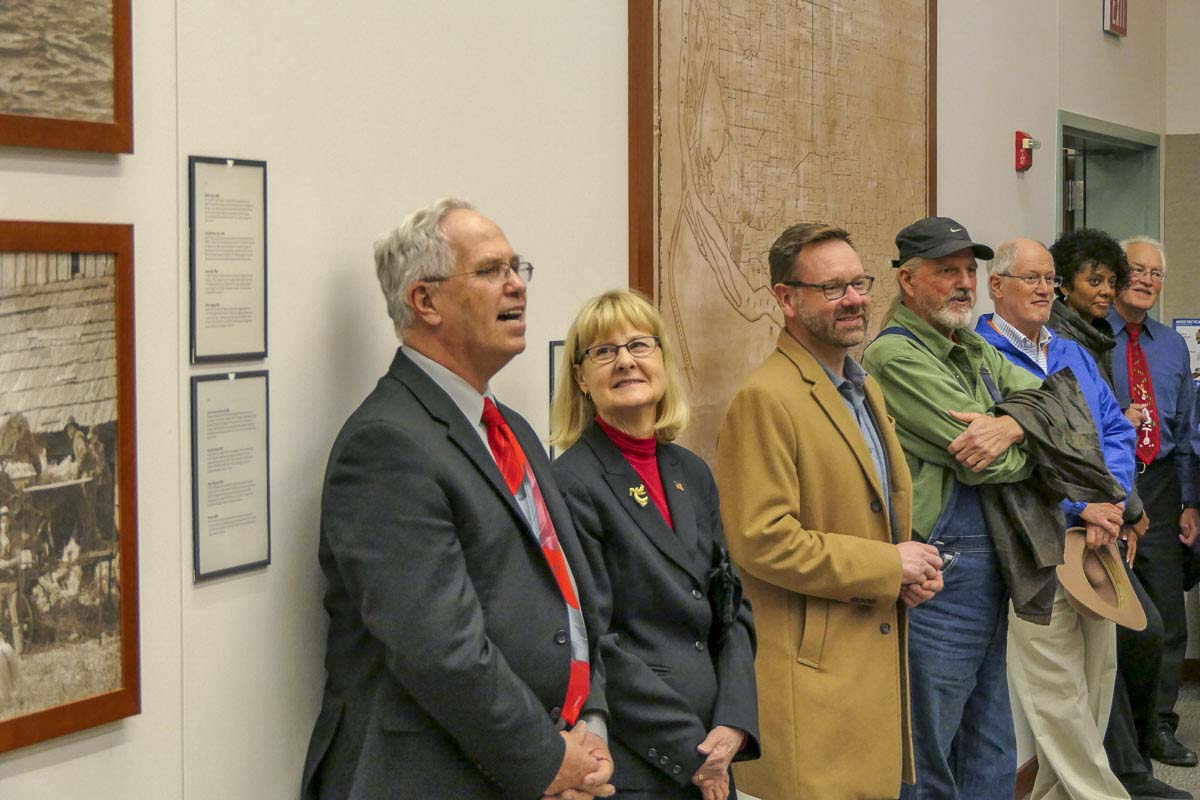 Marc Boldt and Jeanne Stewart listen to remarks at a party to recognize their years on the County Council. Photo by Chris Brown