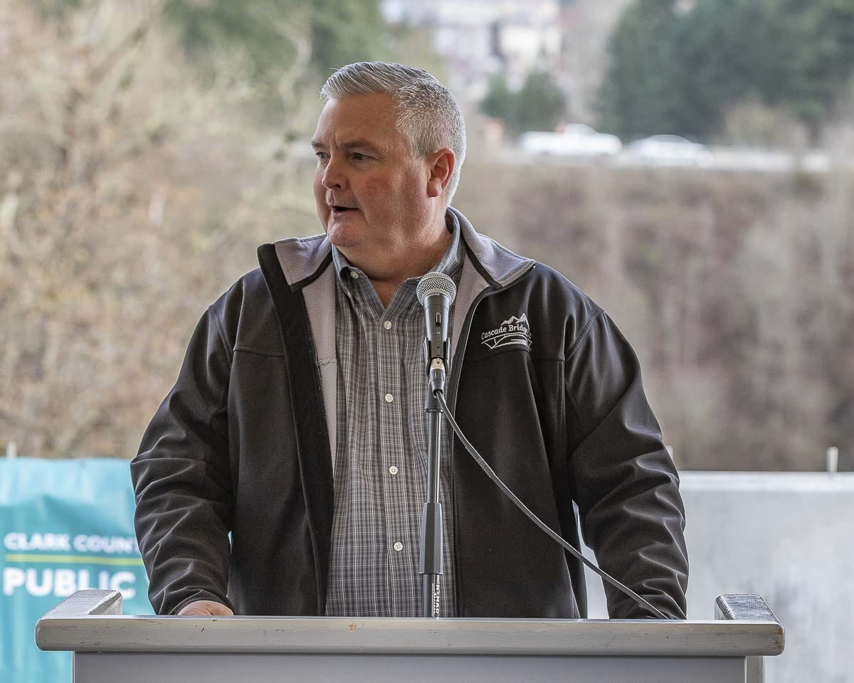 Dave Mingo, GM of Cascade Bridge, speaks at the ribbon cutting for the 10th Avenue Bridge over Whipple Creek. Photo by Mike Schultz