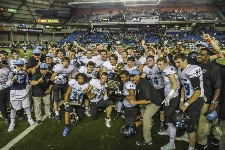 The Hockinson Hawks celebrate after winning the 2017 Class 2A state high school football championship. The Hawks have now won two straight titles and 27 straight games. Photo by Mike Schultz