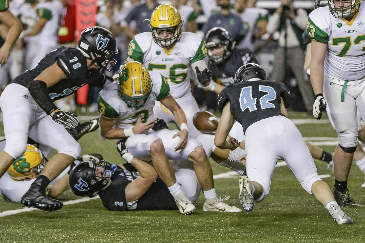 Hockinson linebacker Jonathan Domingos (42) knocks the ball loose from a Lynden ball carrier during Saturday's Class 2A state high school football championship game at the Tacoma Dome. Photo by Mike Schultz