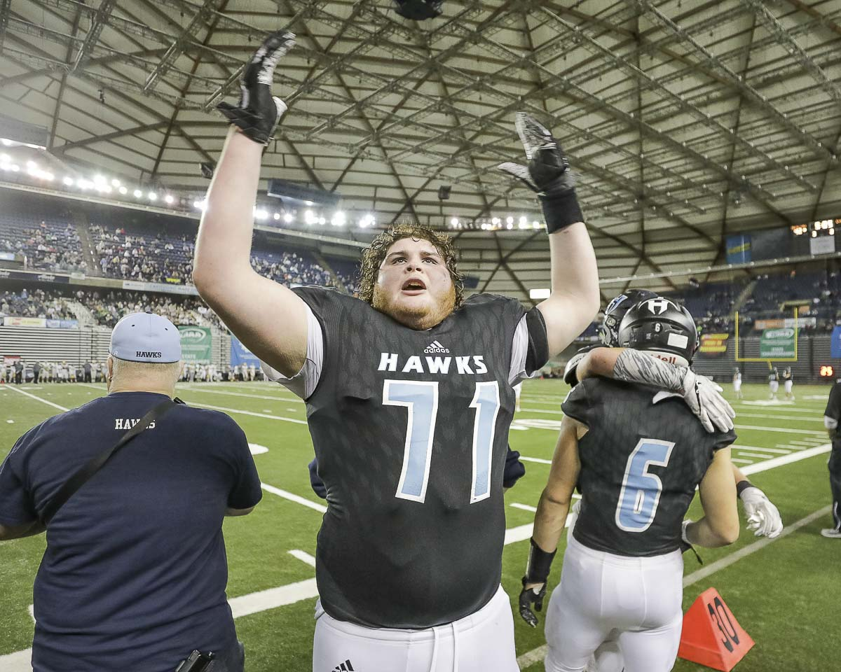 Hockinson lineman Nathan Balderas (71) celebrates Saturday after the Hawks' posted their second consecutive Class 2A state football championship. Balderas and his fellow offensive lineman had key roles in Hockinson's success running the football in the title game. Photo by Mike Schultz