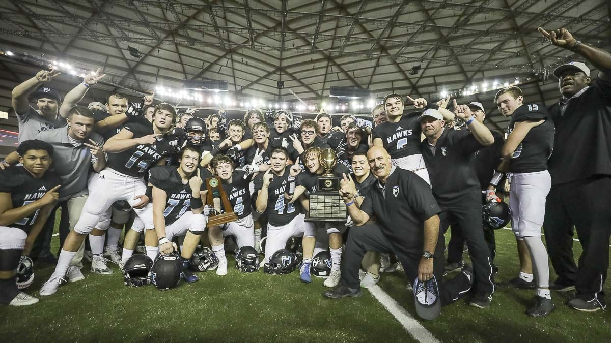 The Hockinson High School football team celebrates Saturday after winning the 2018 Class 2A state high school football championship at the Tacoma Dome. Photo by Mike Schultz