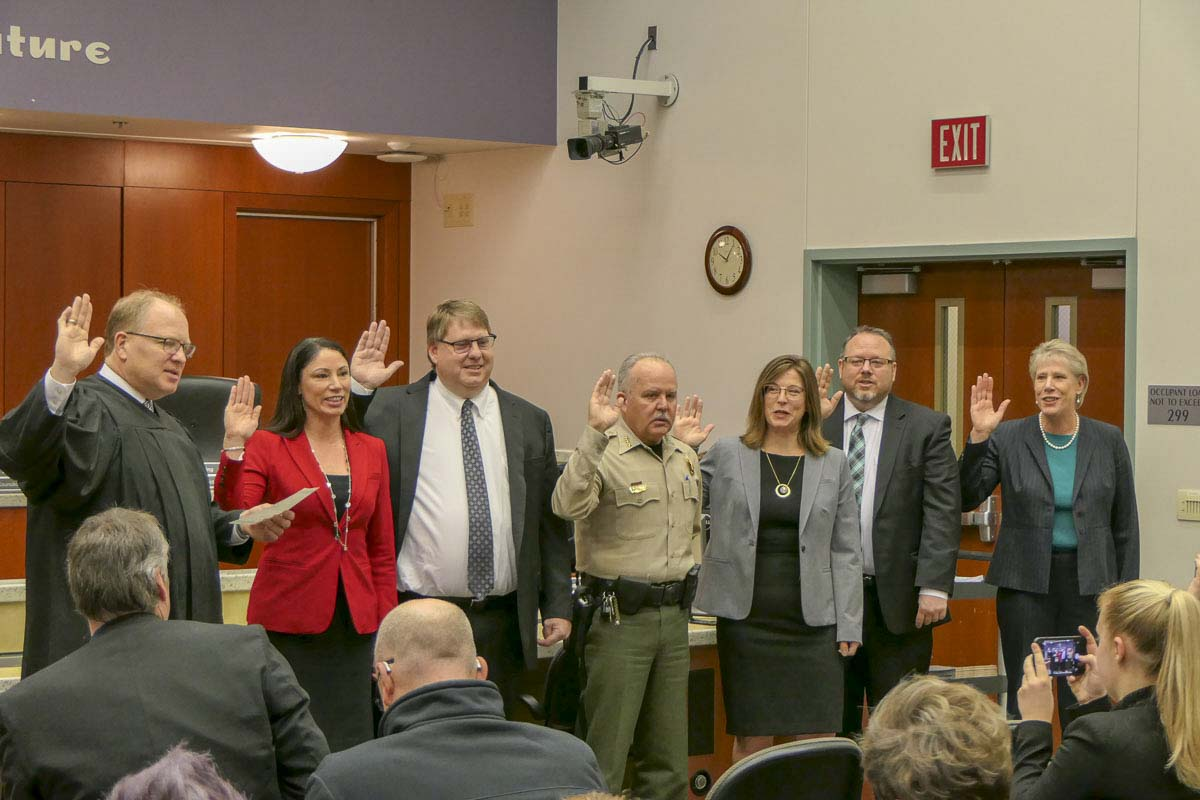 Six elected officials took the oath of office on New Year's Eve day. From left to right — Superior Court Judge David Gregerson, Clark County Treasurer Alishia Topper, Clark County Assessor Peter Van Nortwick, Clark County Sheriff Chuck Atkins, District 1 County Councilor Temple Lentz, Clark County Clerk Scott Weber, District 2 County Councilor Julie Olson. Photo by Chris Brown