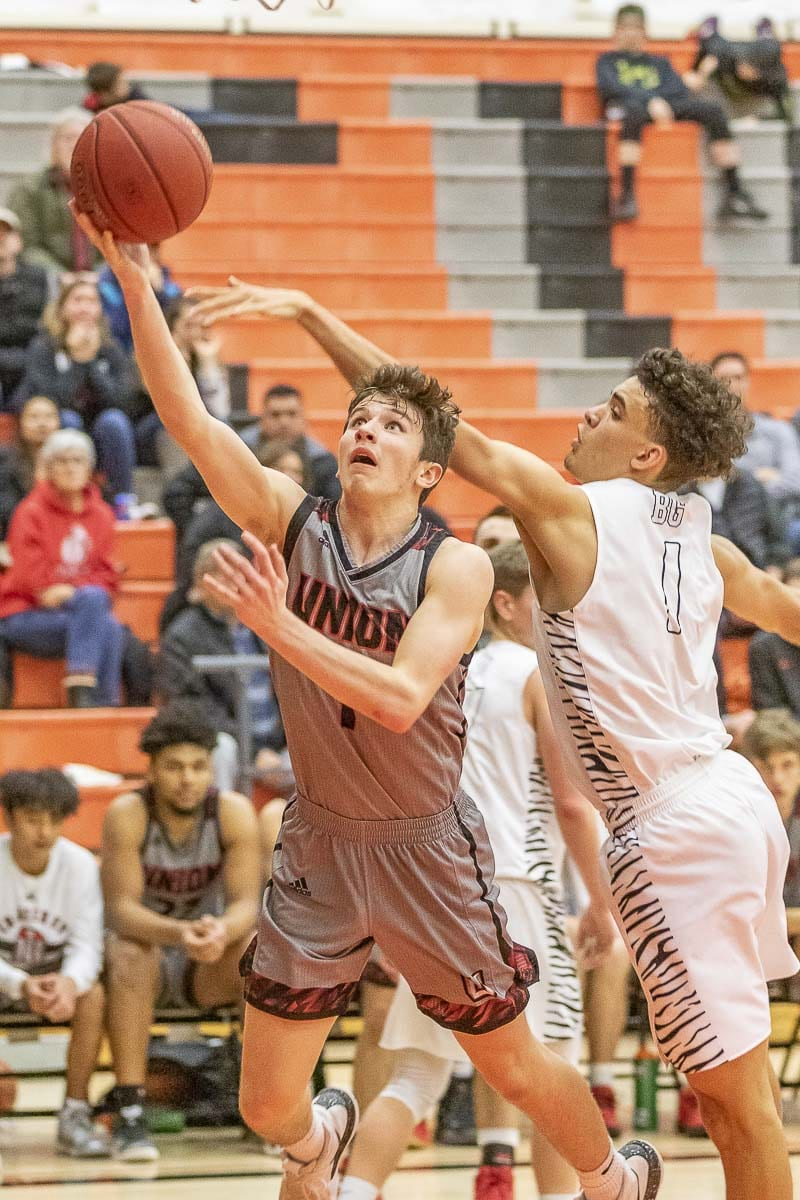 Union's Brad Lackey scored 15 points to pace the Titans. Union outscored Battle Ground 22-2 in the fourth quarter for a 57-41 victory. Photo by Mike Schultz