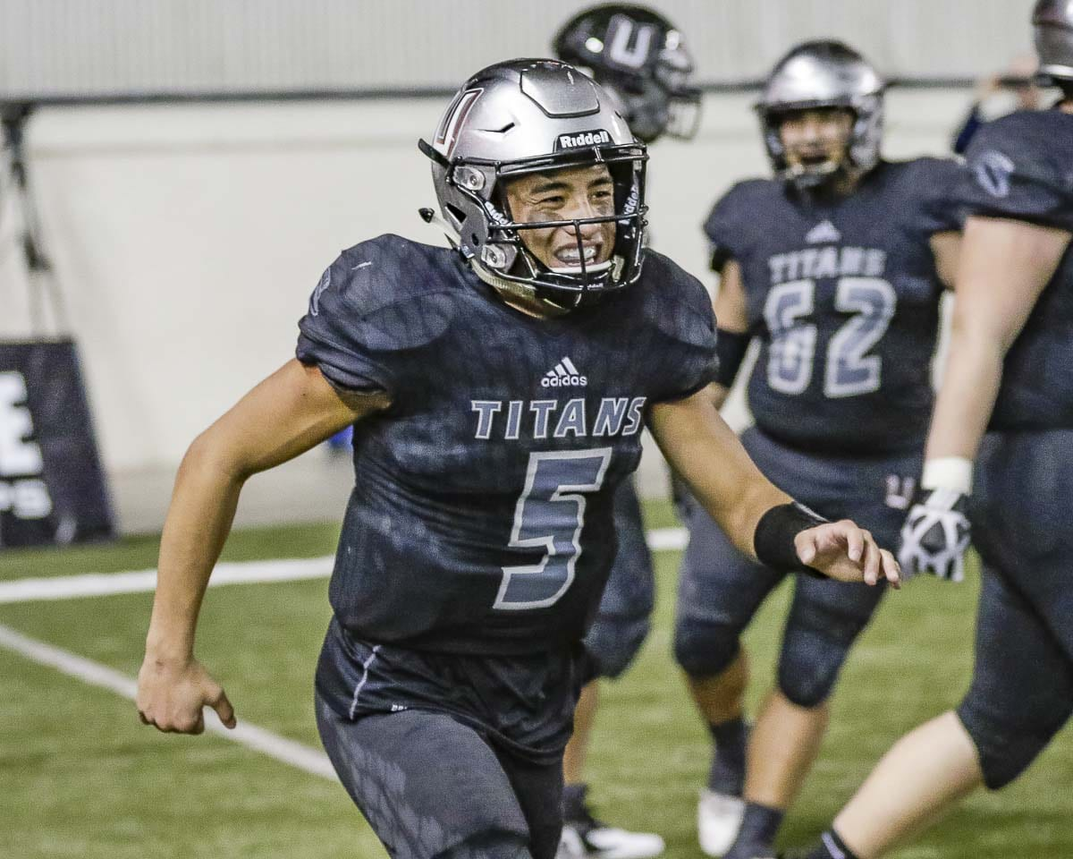 Union's Lincoln Victor (5) was all smiles Saturday after throwing for 327 yards and five touchdowns in the Titans' 52-20 victory over Lake Stevens in the Class 4A state championship game. Photo by Mike Schultz