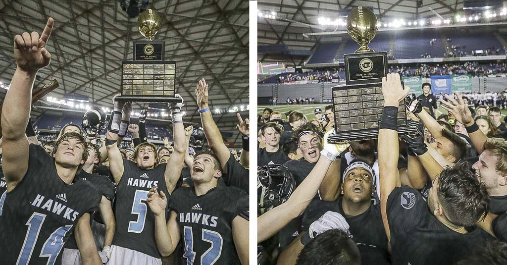 Union and Hockinson players celebrate with the trophies on Dec. 1 in the Tacoma Dome. The Titans and Hawks won state titles that day, the first time Clark County teams won state classification titles on the same day. Photos by Mike Schultz