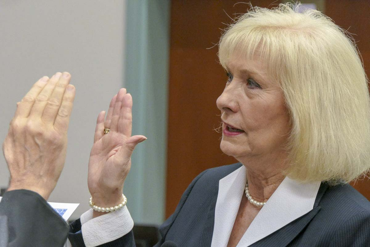 Eileen Quiring takes the oath as the new county chair for Clark County. Photo by Chris Brown