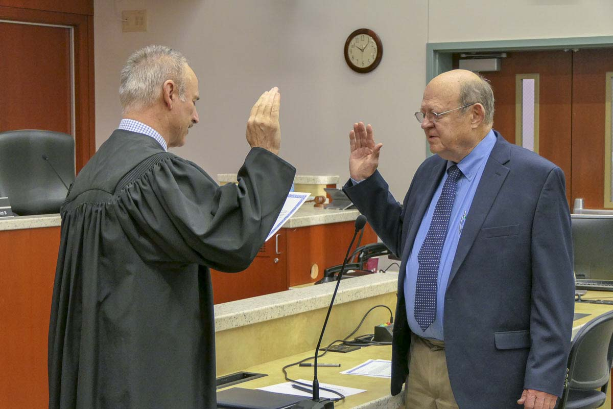Jim Malinowski takes the oath of office for another term as Clark PUD Commissioner. Photo by Chris Brown