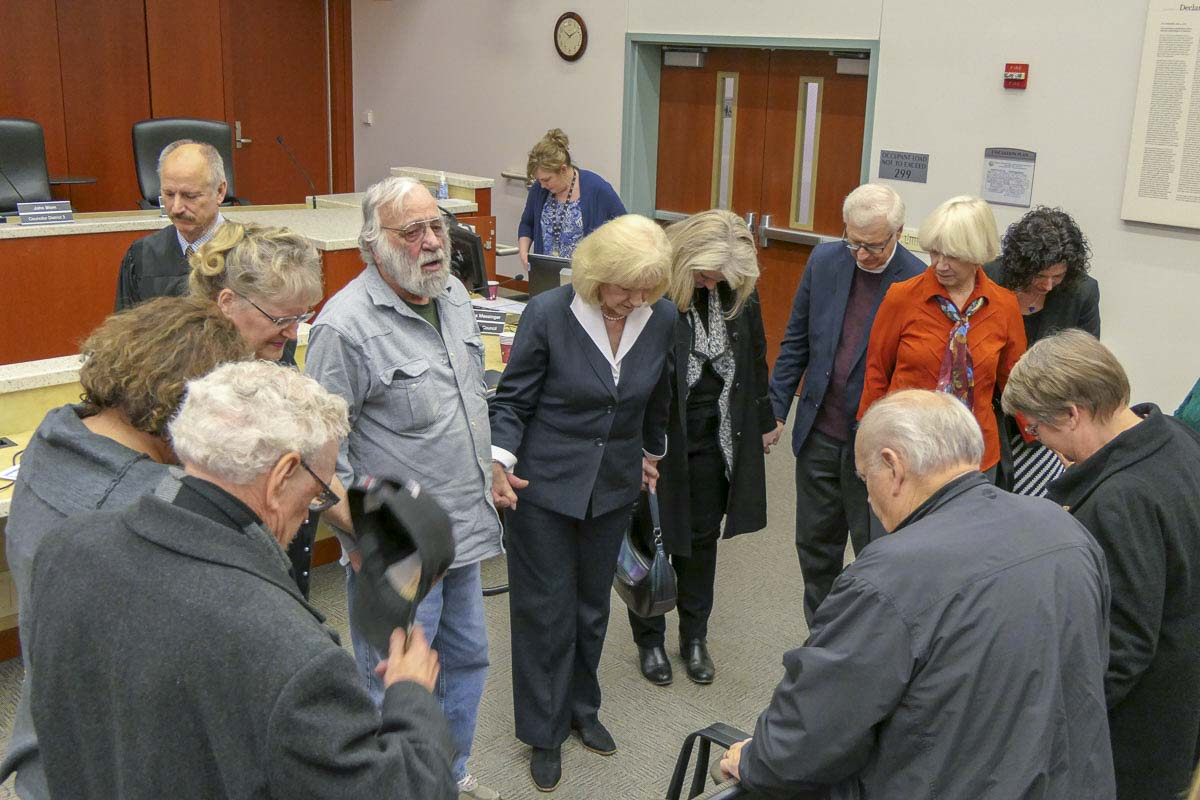 David Alt (center-left) leads a prayer over new Clark County Council Chair Eileen Quiring. Photo by Chris Brown