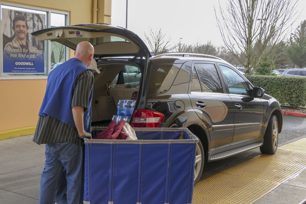 Frank Carlisle drops off items at the Goodwill Store in Fisher's Landing. Photo by Chris Brown