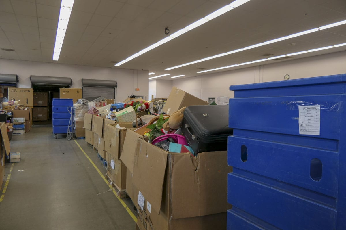 Bins full of donations line the back room at the busiest Goodwill in the local system, off of 162nd in Fisher's Landing. Photo by Chris Brown