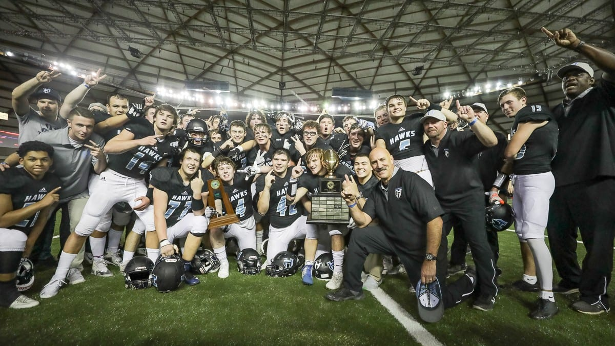 Hockinson's players and coaches celebrate after winning their second consecutive Class 2A state football championship Saturday at the Tacoma Dome. Photo by Mike Schultz