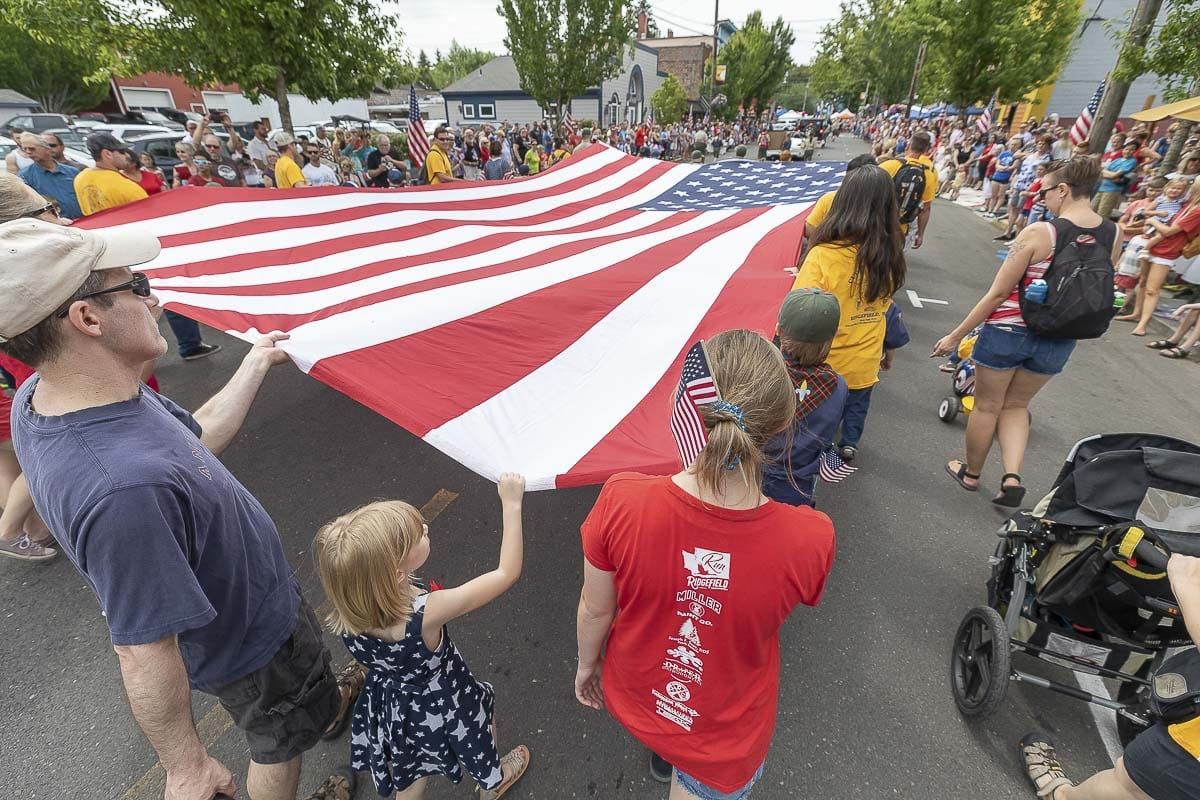 Cub Scout Pack 303 and 310 helped make the annual Fourth of July parade in Ridgefield a patriotic affair. Photo by Mike Schultz