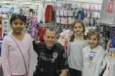 Battle Ground children shop with a cop