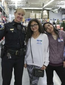 Battle Ground Police Sgt. Kim Anderson is shown here with children who participated in Battle Ground's Shop with a Cop event. Photo courtesy of city of Battle Ground