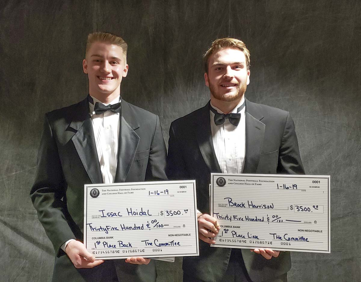 Isaac Hoidal of Stevenson, left, and Brock Harrison of Ridgefield were the first-place winners Wednesday night at the Scholar-Athlete Awards Banquet presented by the Clark County Chapter of the National Football Foundation and College Football Hall of Fame. Photo by Paul Valencia