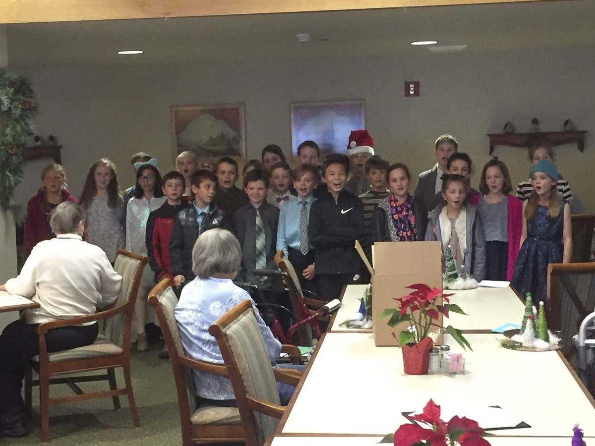South Ridge Elementary School fourth graders perform for residents at Highgate Senior Living Center during a visit in December. Photo courtesy of Ridgefield School District