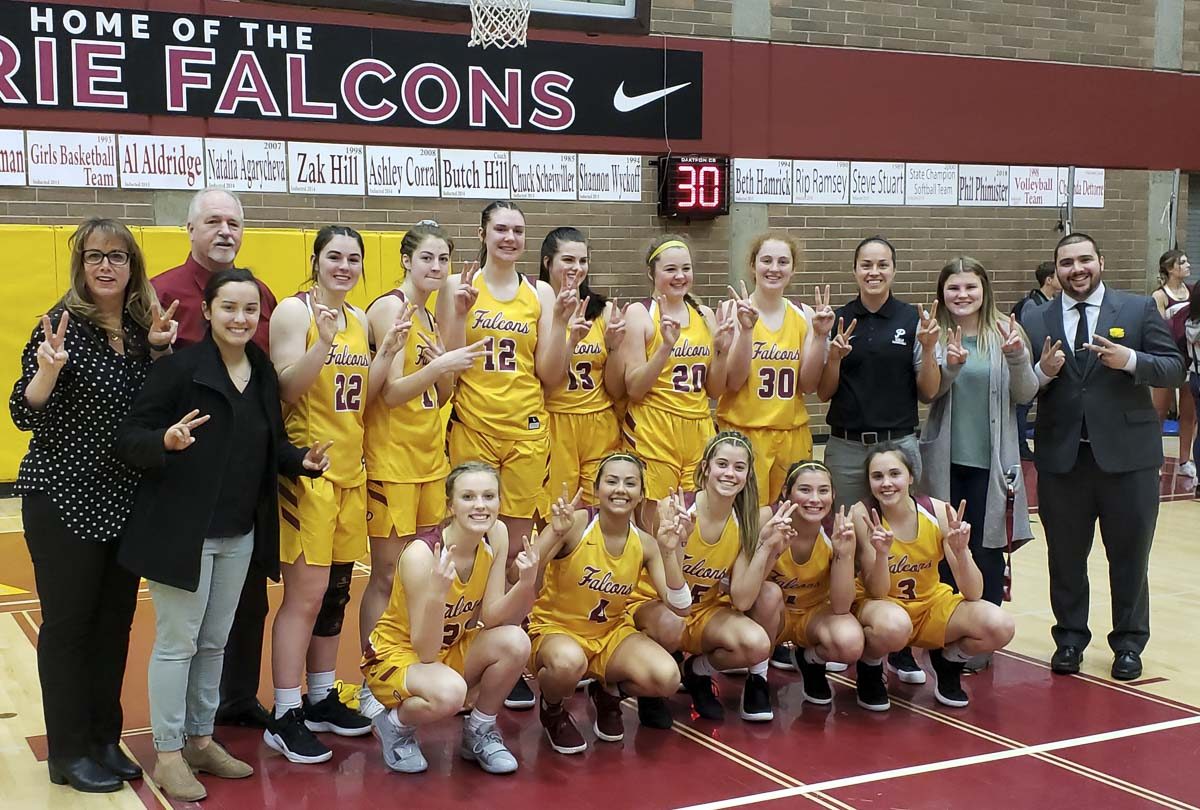 The Prairie Falcons flash 2-and-2 in honor of their 22nd consecutive league title. Photo by Paul Valencia.
