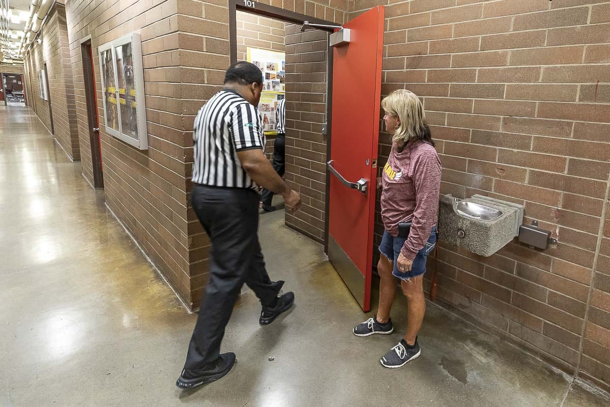 For 26 years, Ralphie Montgomery has been helping game officials with all their needs when working games at Prairie High School. Security and game operations, Montgomery knows all there is about hosting sporting events. She is saying goodbye to the job this season. Photo by Mike Schultz
